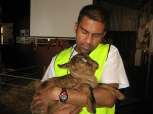 Ron and a Rescued Baby Goat